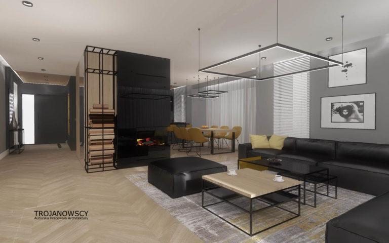 salon z czarnymi kanapami drewniana podłoga jodełka