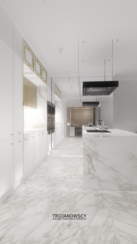 biała kuchnia z marmurową wyspą i kamienną posadzką