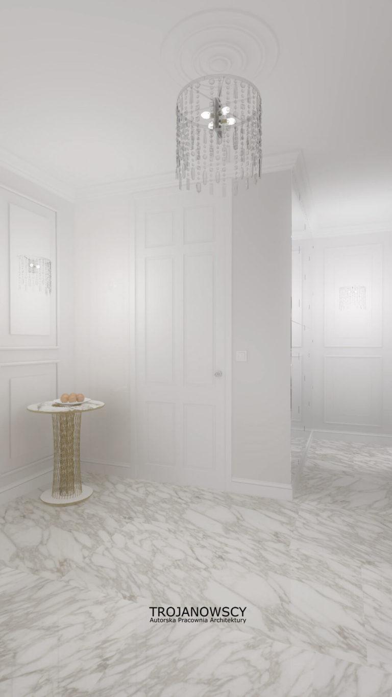 białe wnętrze z oryginalnym żyrandolem