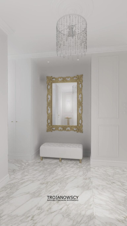 białe ekskluzywne wnętrze ze złotym lustrem